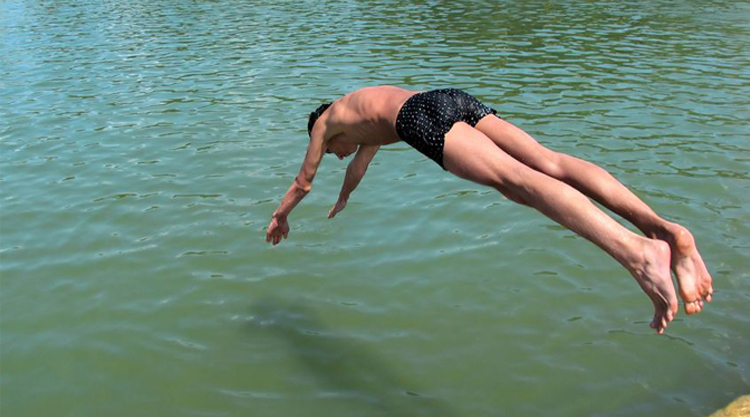 swimmer diving into water