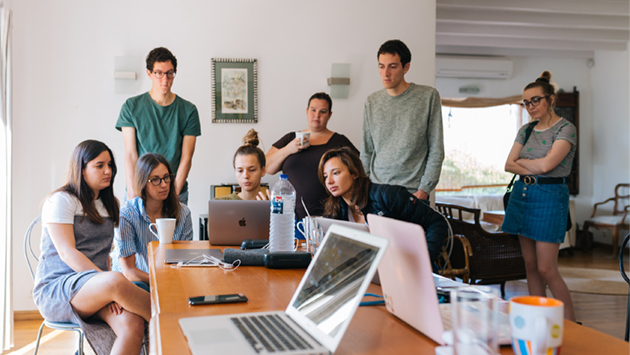 team members looking at a laptop